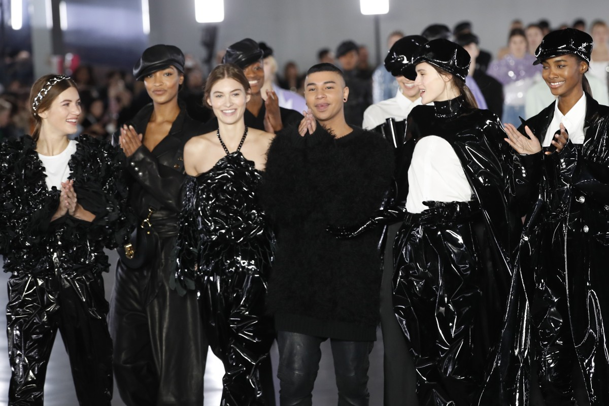 81008fe5db6 Designer Olivier Rousteing (centre) poses with models after Balmain s ready- to-wear