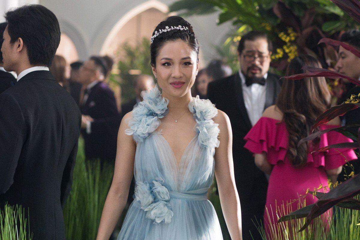 e92b241594d Constance Wu wearing the blue gown in Crazy Rich Asians. Photo  Warner Bros