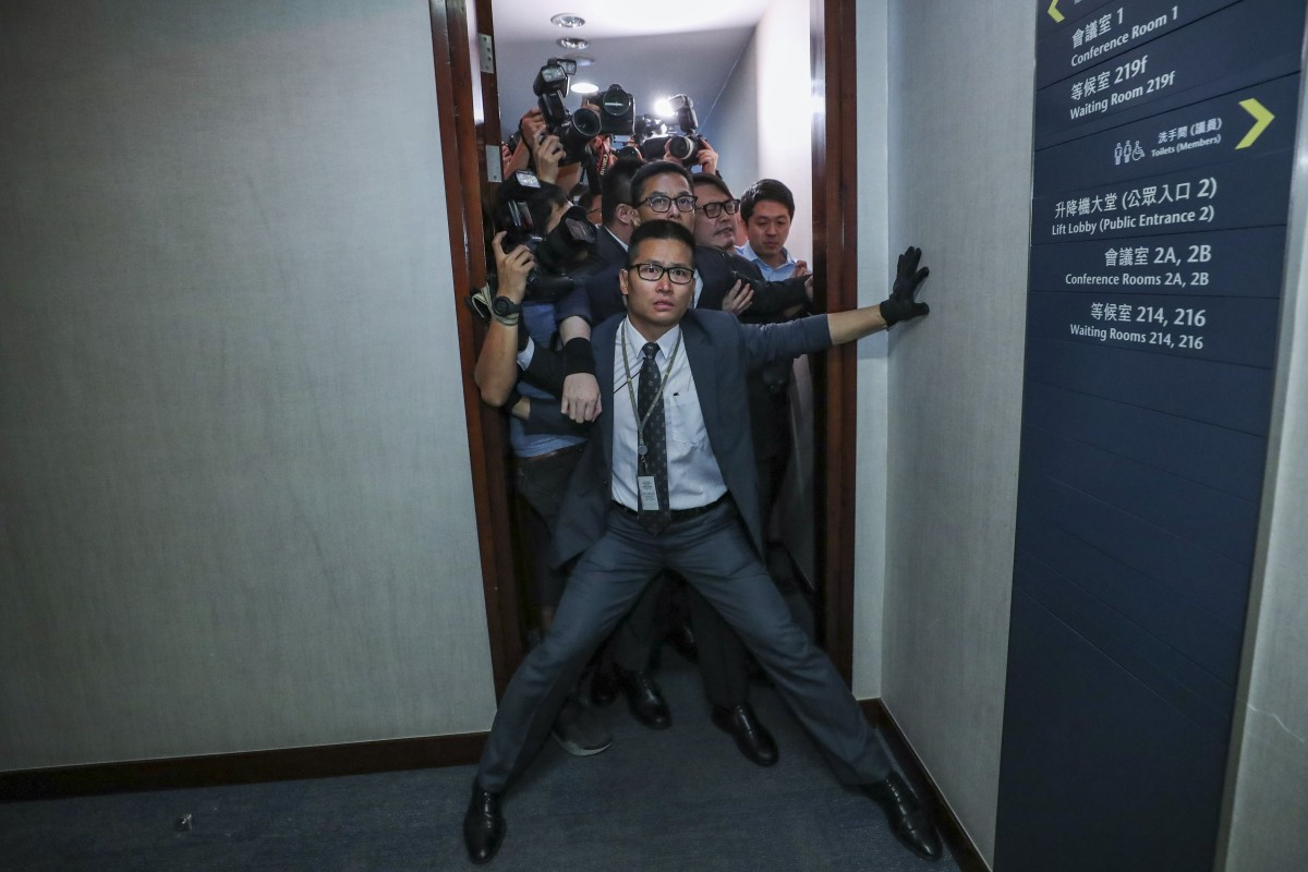 360e1812 A security officer tries to stop reporters from entering the bills  committee meeting. Photo: