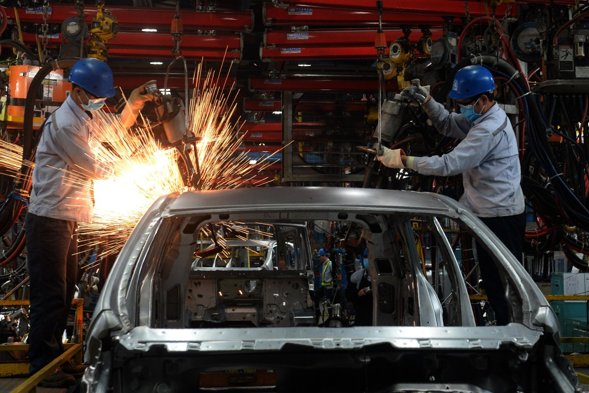 Vietnamese employees weld at a car plant in Hai Duong. The country stands to gain from the US-China trade war. Photo: AFP