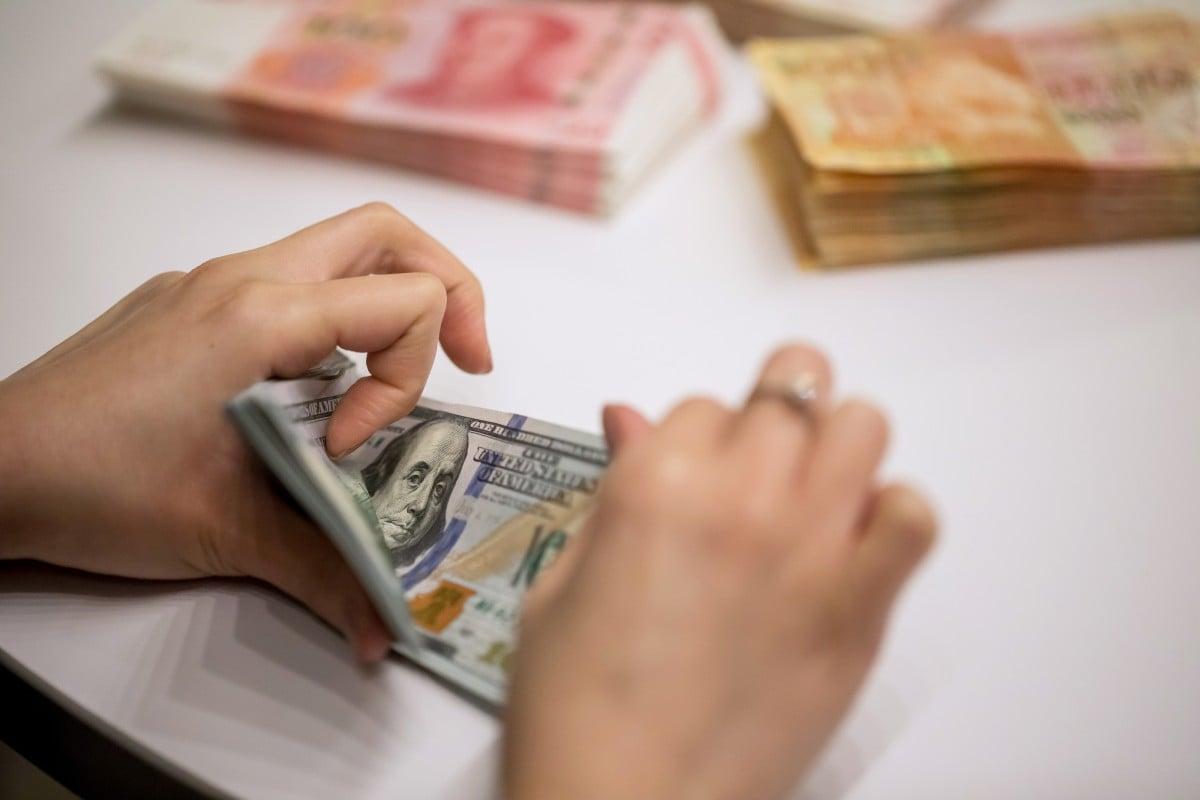 Hong Kong's dollar weakens below low end of trading band as