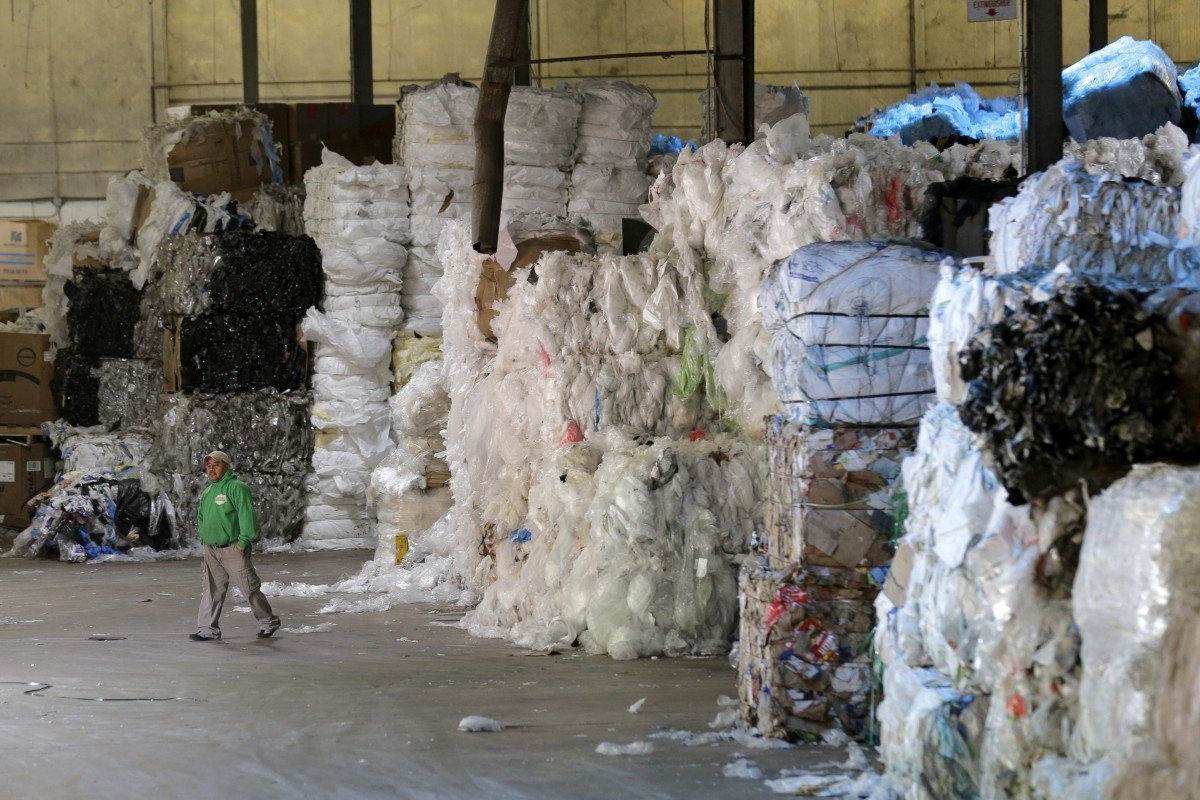 China phased in import restrictions on scrap paper and plastics in January last year. Photo: AP