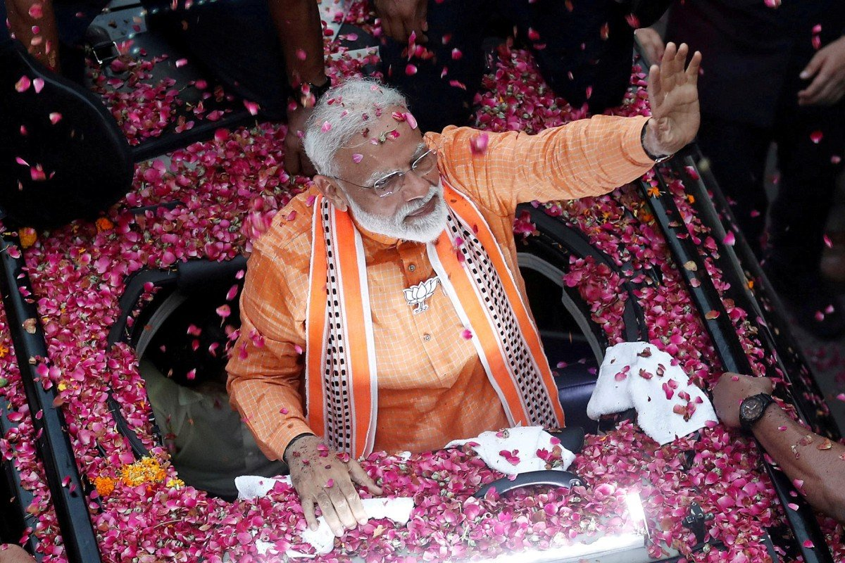 India election: Narendra Modi's BJP coalition looks set to retain