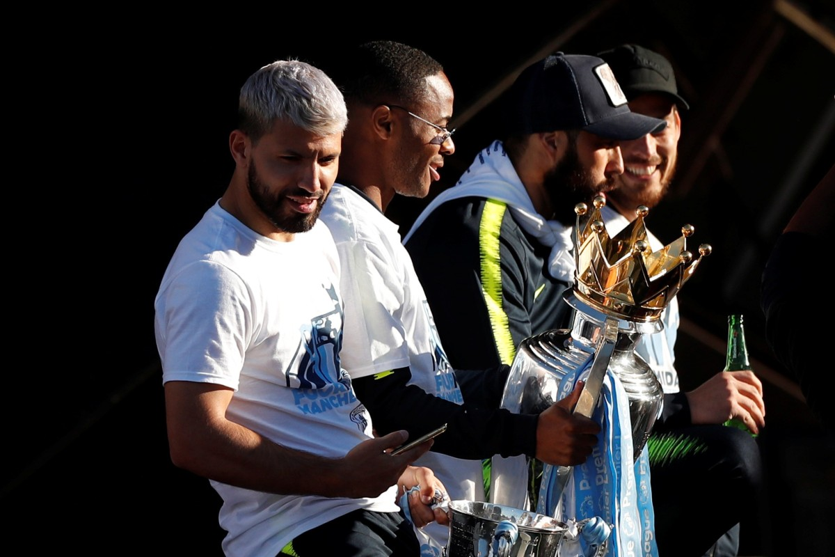90008cb0b6f44 Manchester City's Sergio Aguero, Raheem Sterling and teammates celebrate  with the English Premier League trophy