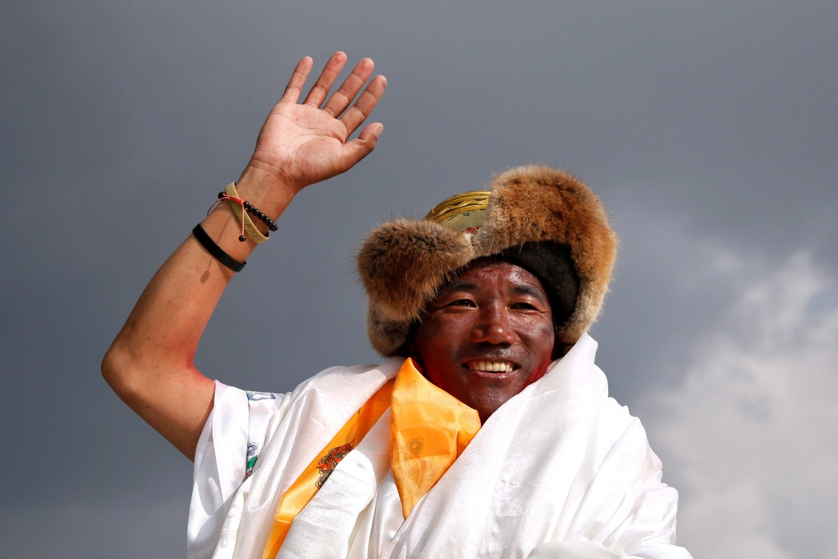 'I was just working': Nepali mountain guide summits Mount Everest for the 23rd and 24th time in the same week