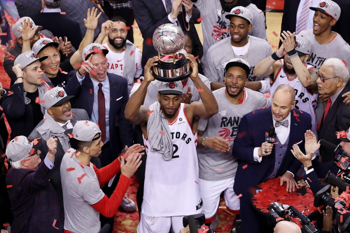 9a34c557d83 Kawhi Leonard of the Toronto Raptors celebrates with the Eastern Conference  trophy after defeating the Milwaukee
