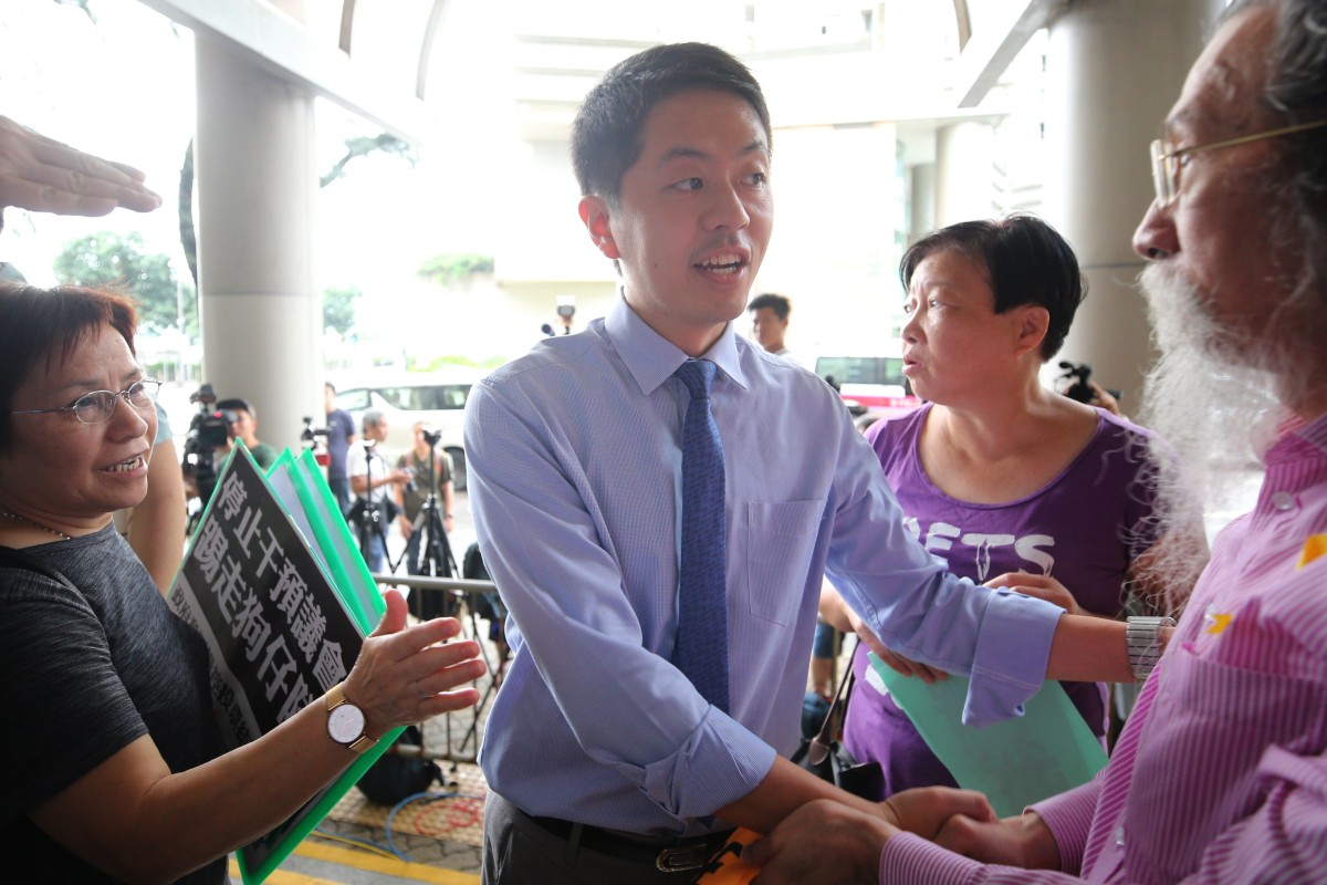 Hong Kong lawmaker Ted Hui guilty of assault after snatching public official's phone, dashing to men's...