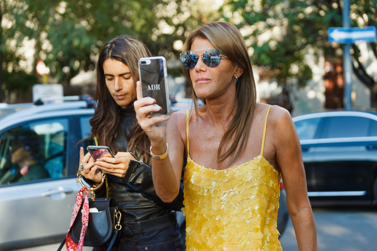 66545dacefa2 Vogue Japan's Anna Dello Russo with her personalised phone case at Milan Fashion  Week. Photo