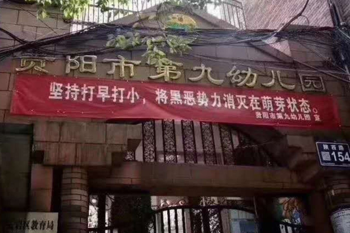 "A kindergarten in Guiyang put up a banner on its entrance that read: ""Crack down early and crack down young. Eliminate the dark and evil forces when they are still budding"". It was later removed. Photo: Weibo"