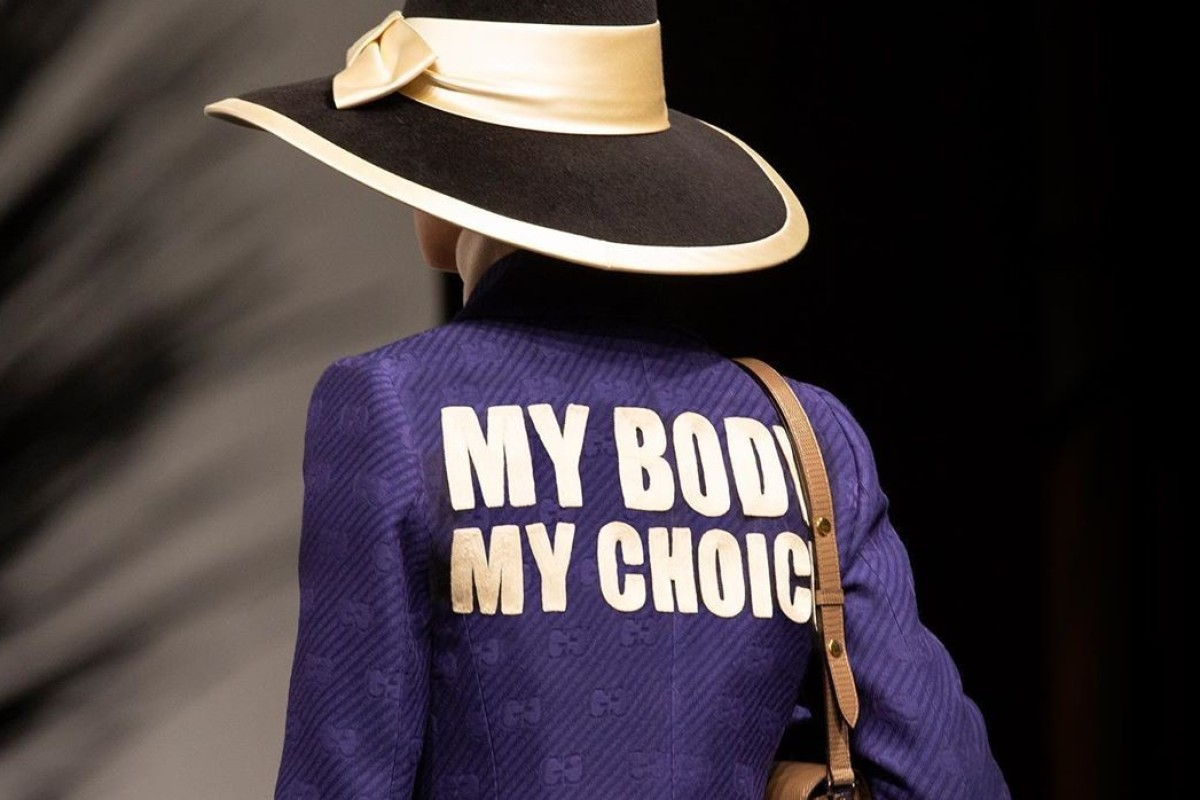 edbb339c169d79 A runway model wears a purple jacket with the abortion rights message, 'My  Body