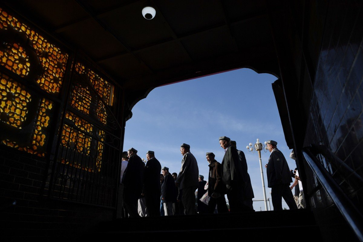 Worshippers leave a mosque in Kasghar after prayers on Wednesday. Photo: AFP