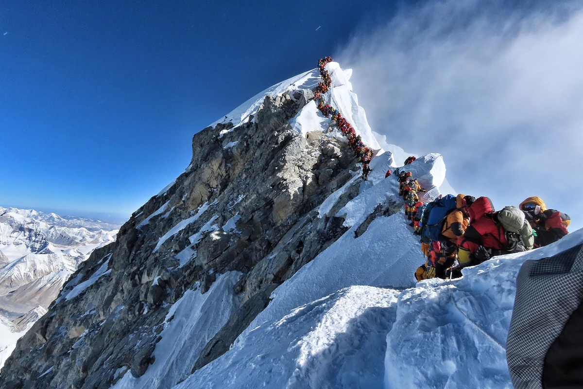 cb3e7e46b14 Climbers line up for hours to reach the summit of Mount Everest on May 22.