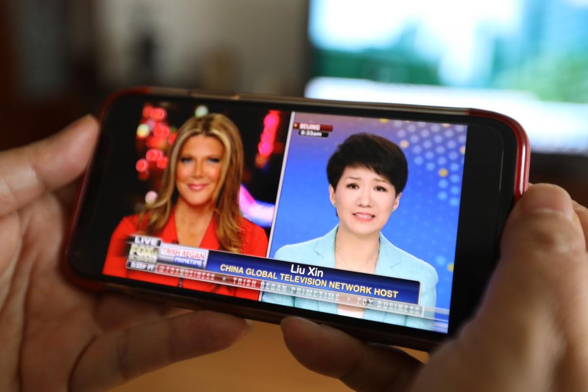 Round two: CGTN anchor Liu Xin and Fox's Trish Regan prepare