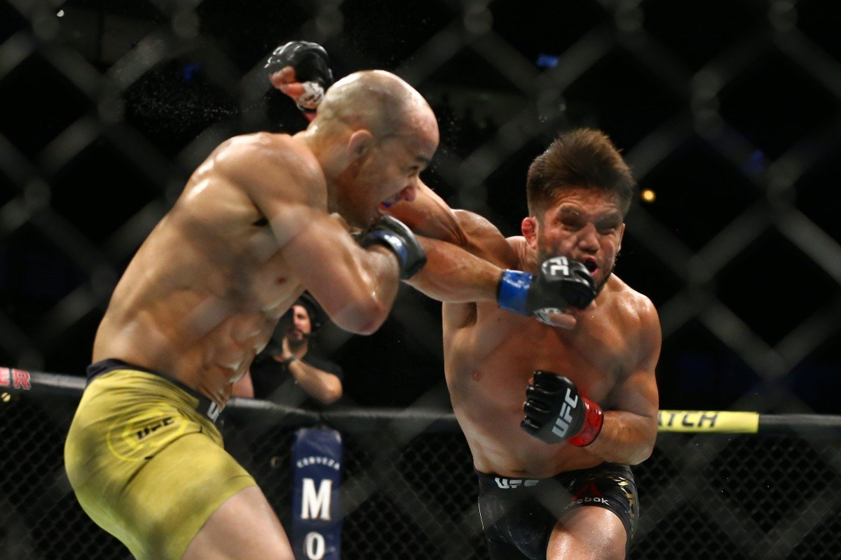 17b03b82dd5f Marlon Moraes lands a shot on Henry Cejudo in their bantamweight  championship bout at UFC 238