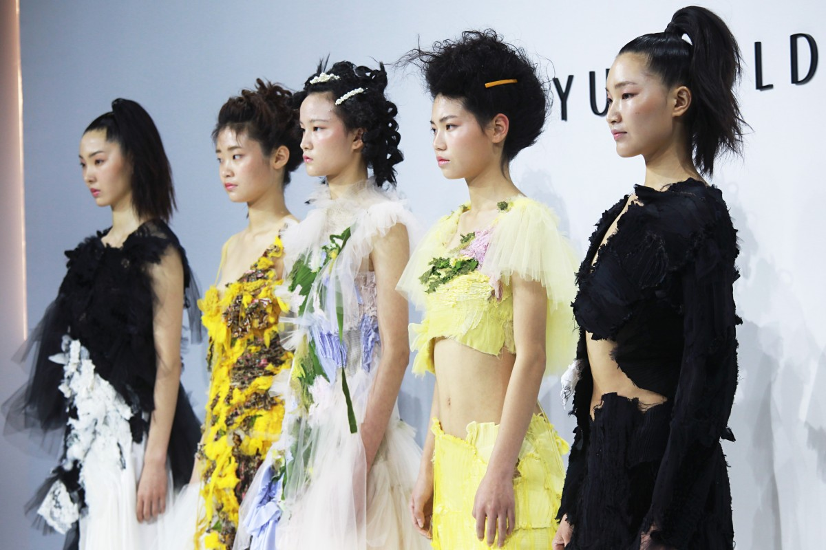 a6da21bb8 Models present creations by Caroline Hu at Shanghai Fashion Week in March,  where the Chinese