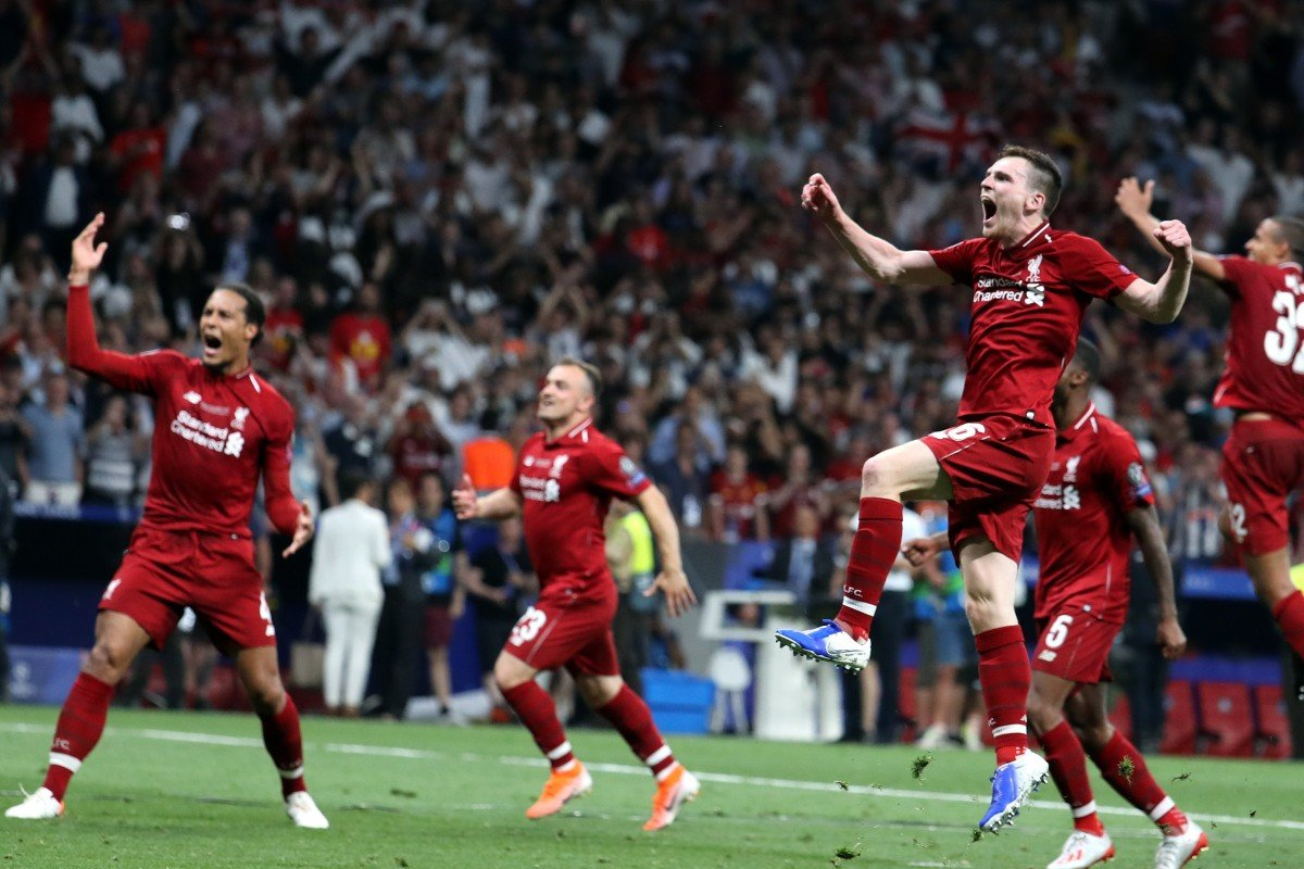 5d1ef5f62c1 Liverpool's Andy Robertson (right) leaps in joy after the Uefa Champions  League final.