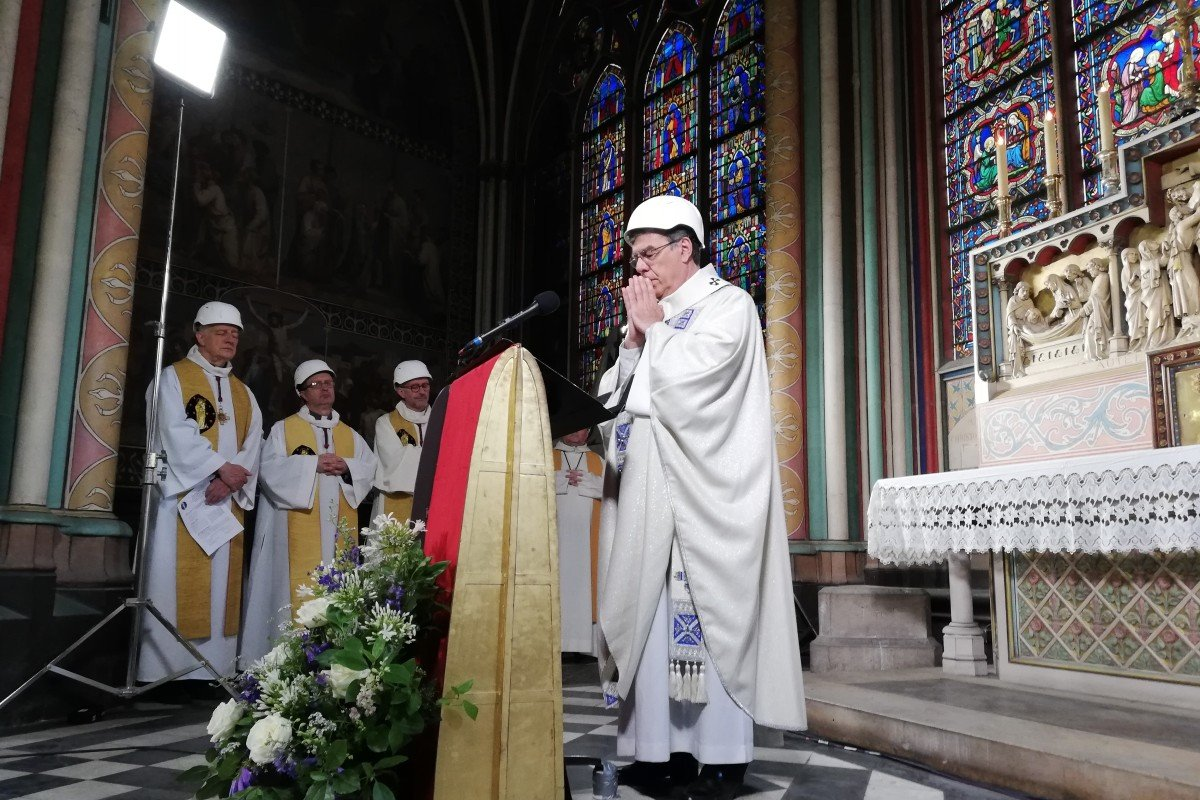Priests and worshippers don helmets as Notre Dame Cathedral holds first mass since devastating blaze