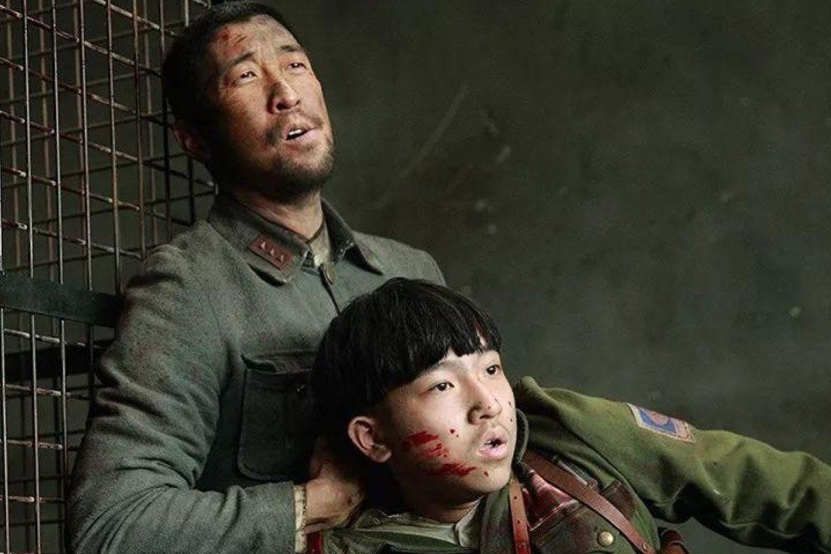 Wang Qianyuan (top) and Zhang Junyi in The Eight Hundred, a film about the Battle of Shanghai which was pulled from the Shanghai International Film Festival.