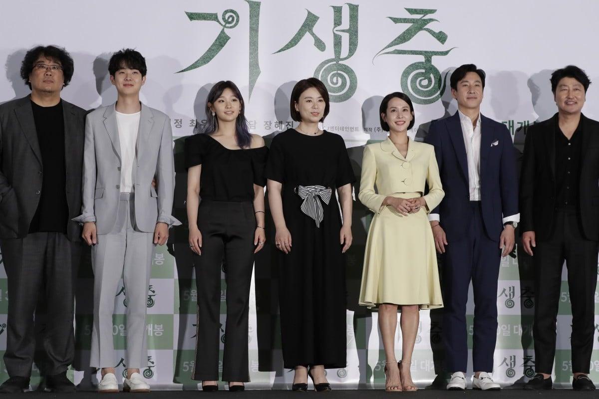 eede0b4c7 South Korean director Bong Joon-ho, left, with cast members of Parasite.