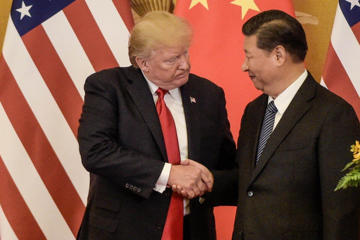 Presidents Donald Trump and Xi Jinping, seen here in November 2017, need to bridge their differences to avoid tipping the world economy over the edge. Photo: AFP