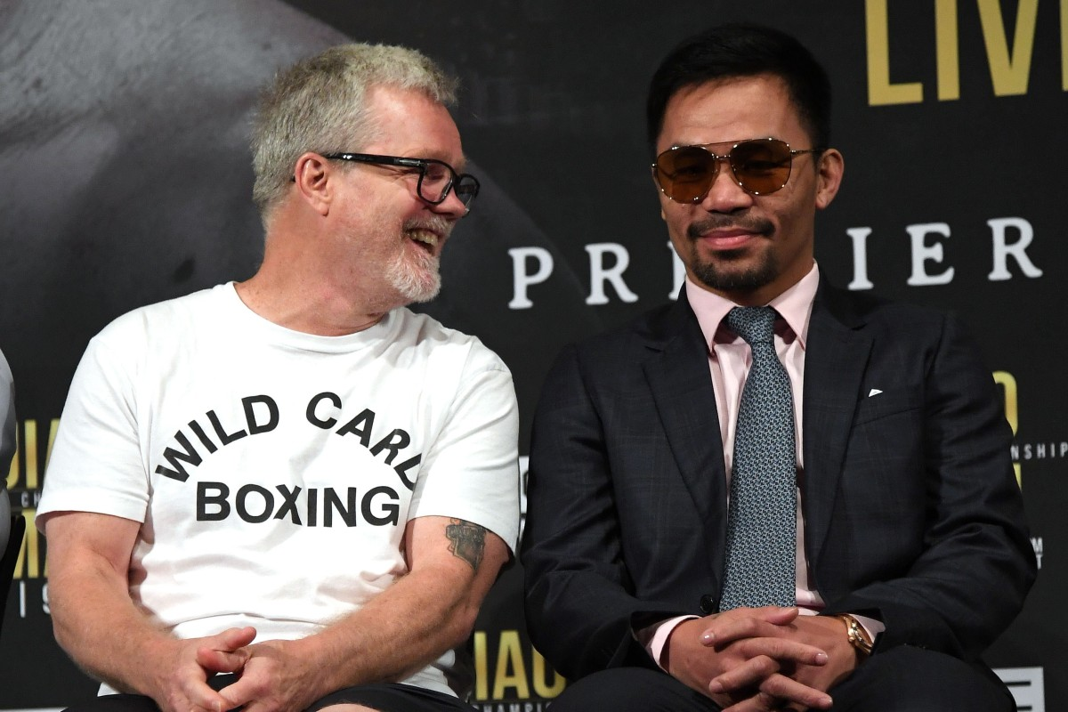 brand new 5baee 2cdee Trainer Freddie Roach laughs with Manny Pacquiao during the press  conference for their fight against Keith