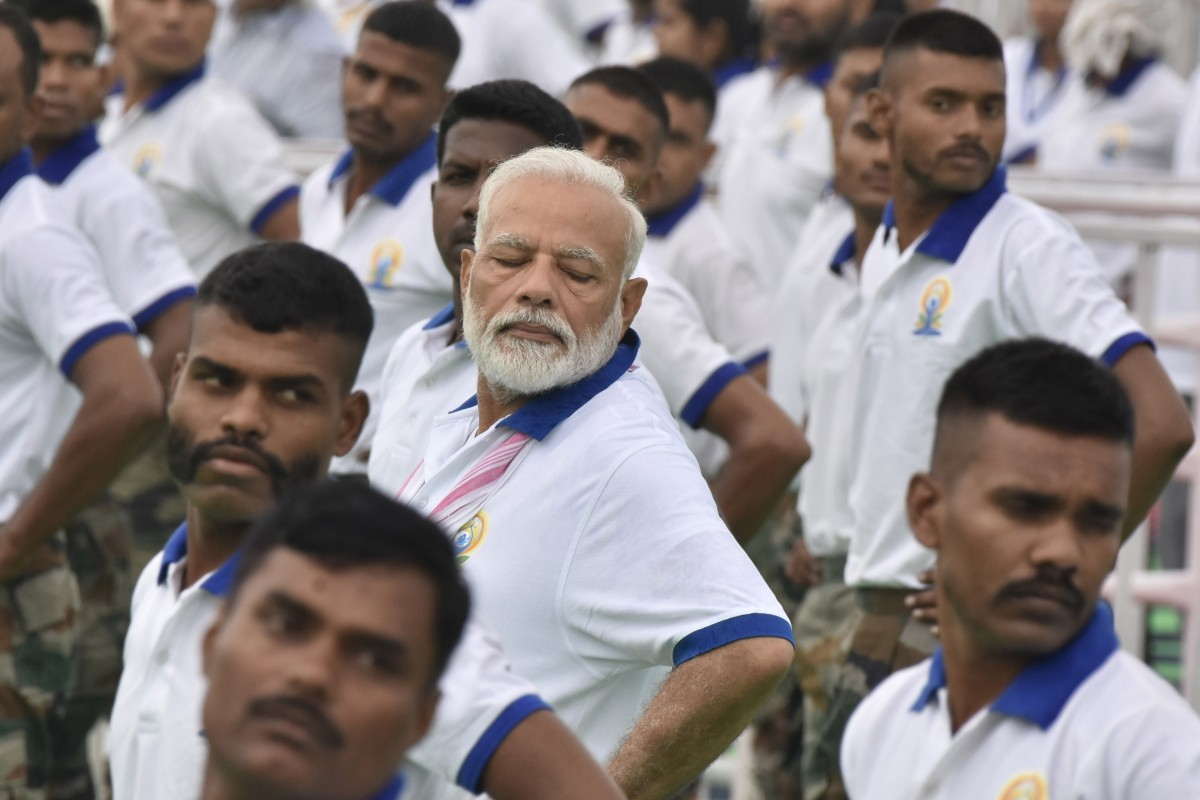 Narendra Modi and Indians stretch, bend to mark