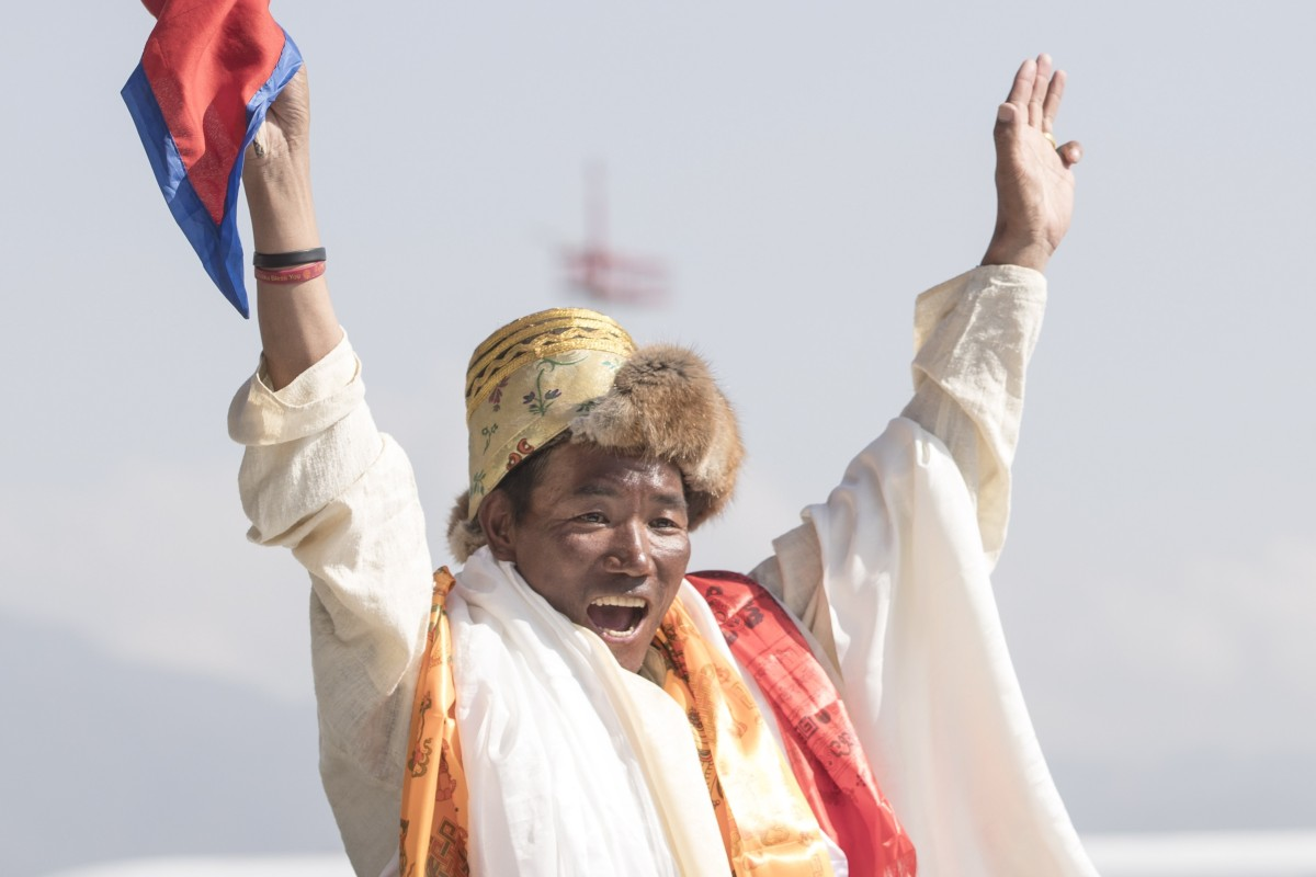208c424d155 Kami Rita Sherpa celebrates setting a new world record for climbing Mount  Everest. Photo: