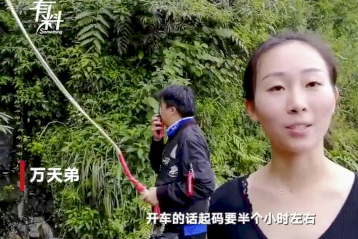 Chinese woman drops in on work colleagues – from a height of 300 metres