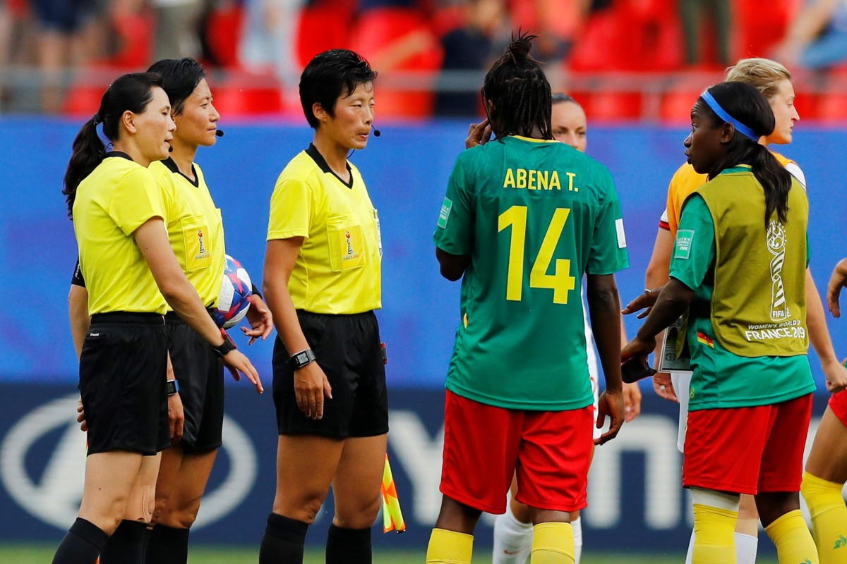 7d6d3a9f6 Cameroon's Ninon Abena and teammates remonstrate with referee Qin Liang  after the match. Photo: