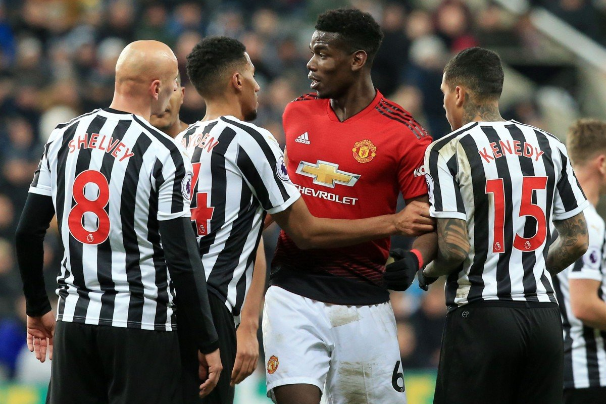 4328b6986 Manchester United's Paul Pogba remonstrates with several Newcastle United  players. Photo: AFP