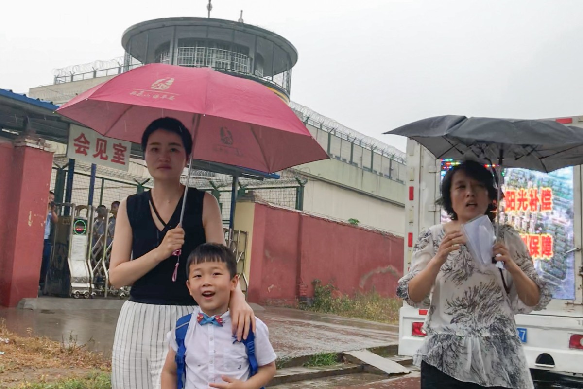 Li Wenzu and Wang Guangwei, the wife and son of jailed lawyer Wang Quanzhang, outside the prison in Shandong with his sister Wang Quanxiu (right). Photo: Handout