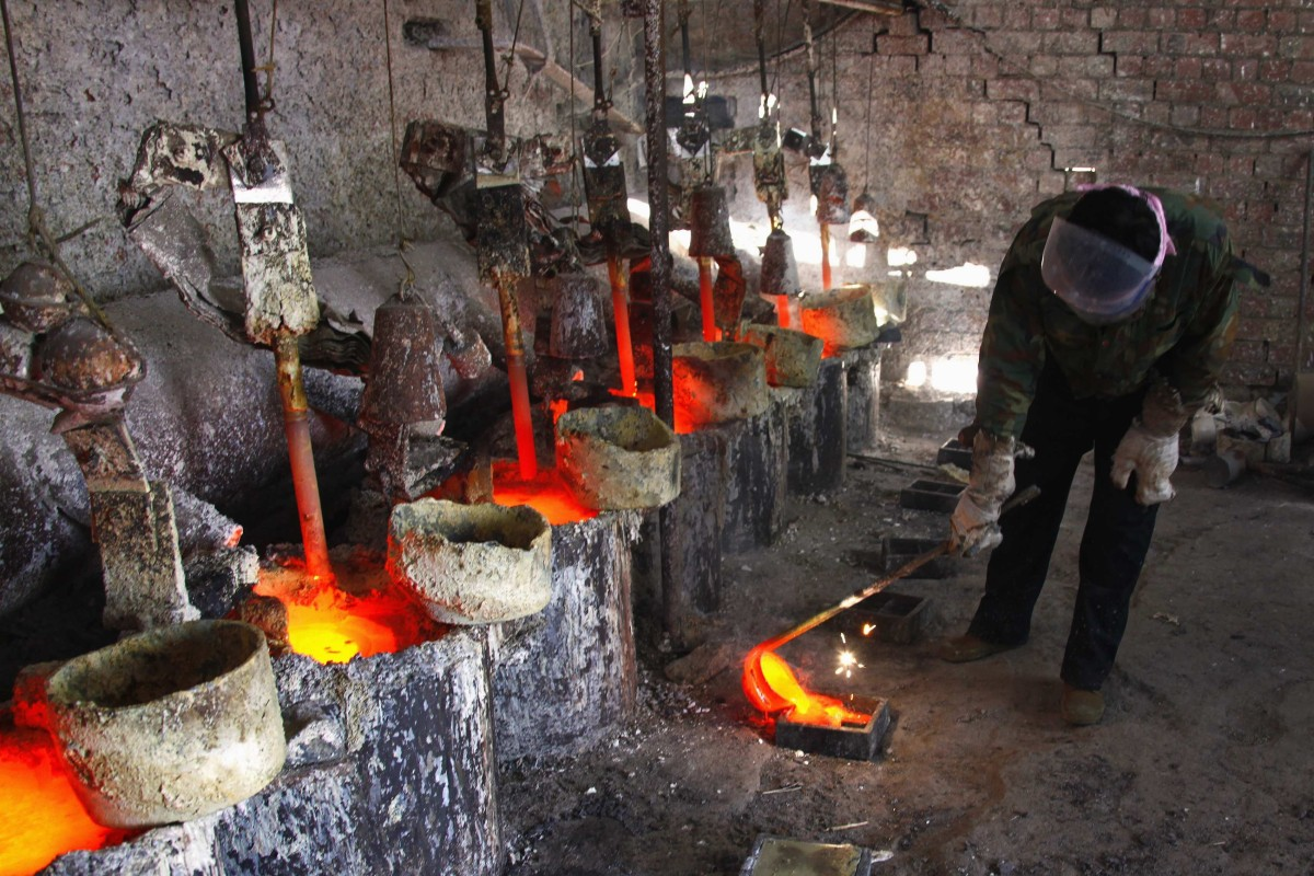 The rare earth metal lanthanum is poured into a mould in China's Inner Mongolia autonomous region. The country supplies more than 70 per cent of the world's rare earth oxides. Photo: Reuters