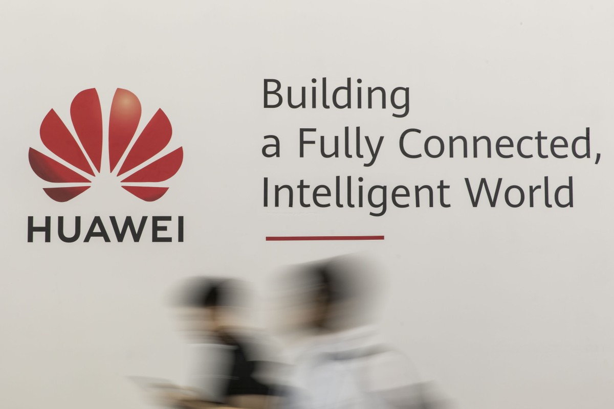 Attendees walk past a sign for Huawei Technologies at the MWC Shanghai 2019 trade show on June 27. Photo: Bloomberg