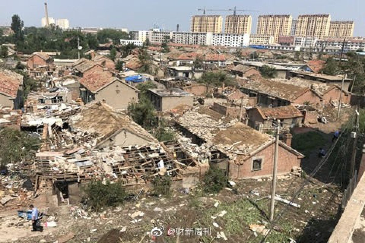 Residents try to pick up the pieces after a deadly tornado destroyed homes and factories in Kaiyuan, Liaoning province, on Wednesday afternoon. Photo: Weibo