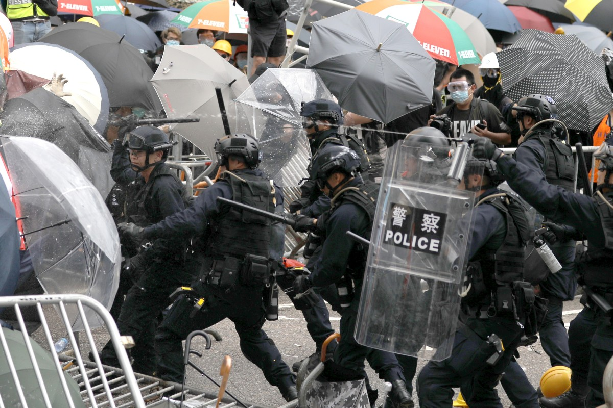 ef0bb7c0a21a Riot police use pepper spray to disperse protesters in Hong Kong on June  12. Photo