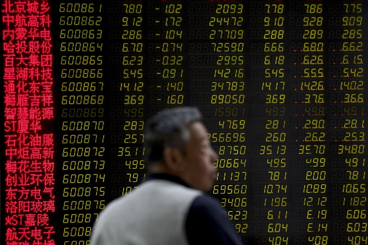 957804d7 A man monitors stock prices at a brokerage house in Beijing on May 14, 2019
