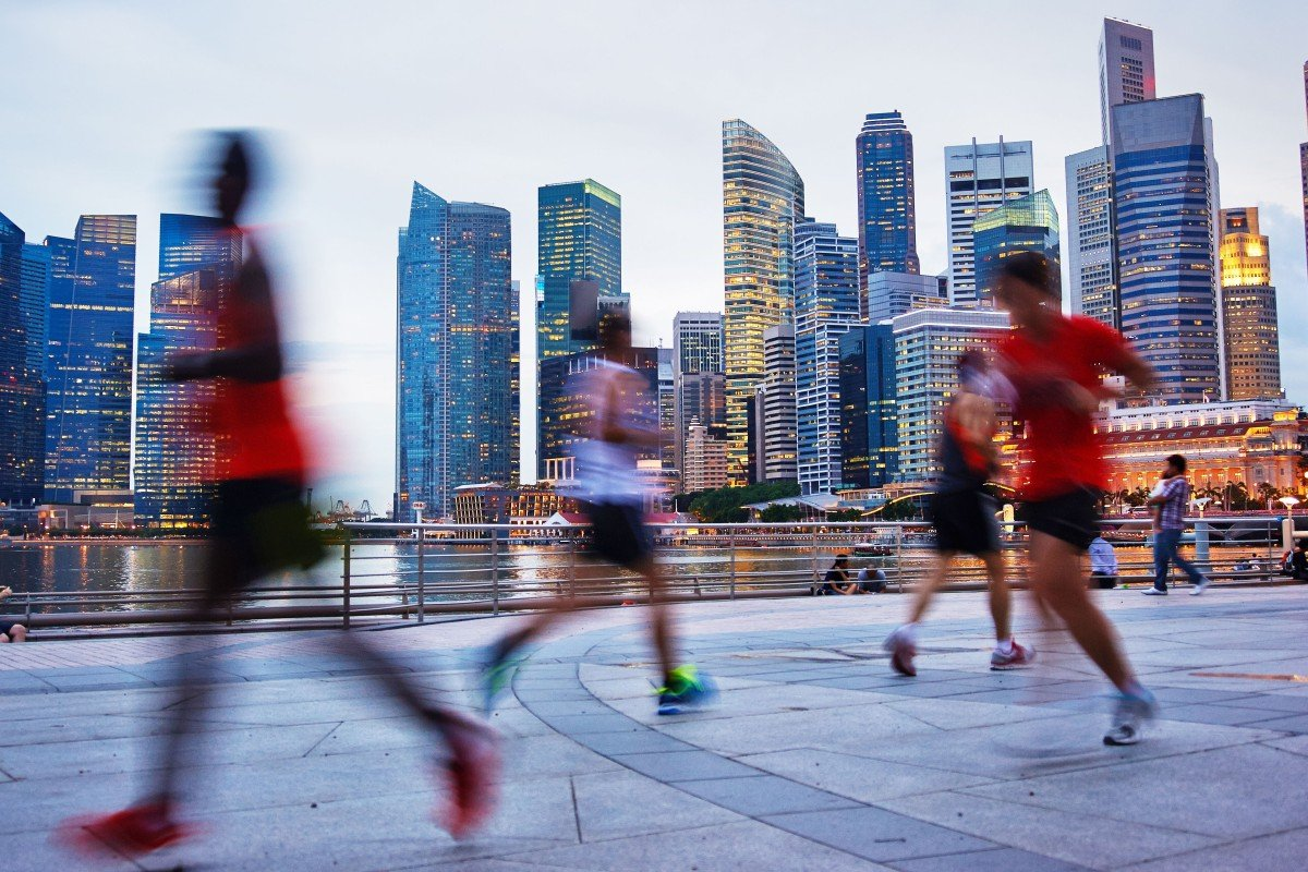 3bee278acb297 Runners go for an evening jog in Singapore. The Lion City is a popular  destination