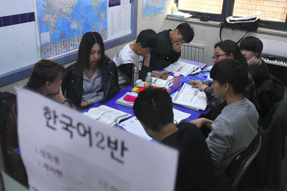 North Korean defectors head back to school in the South to 're