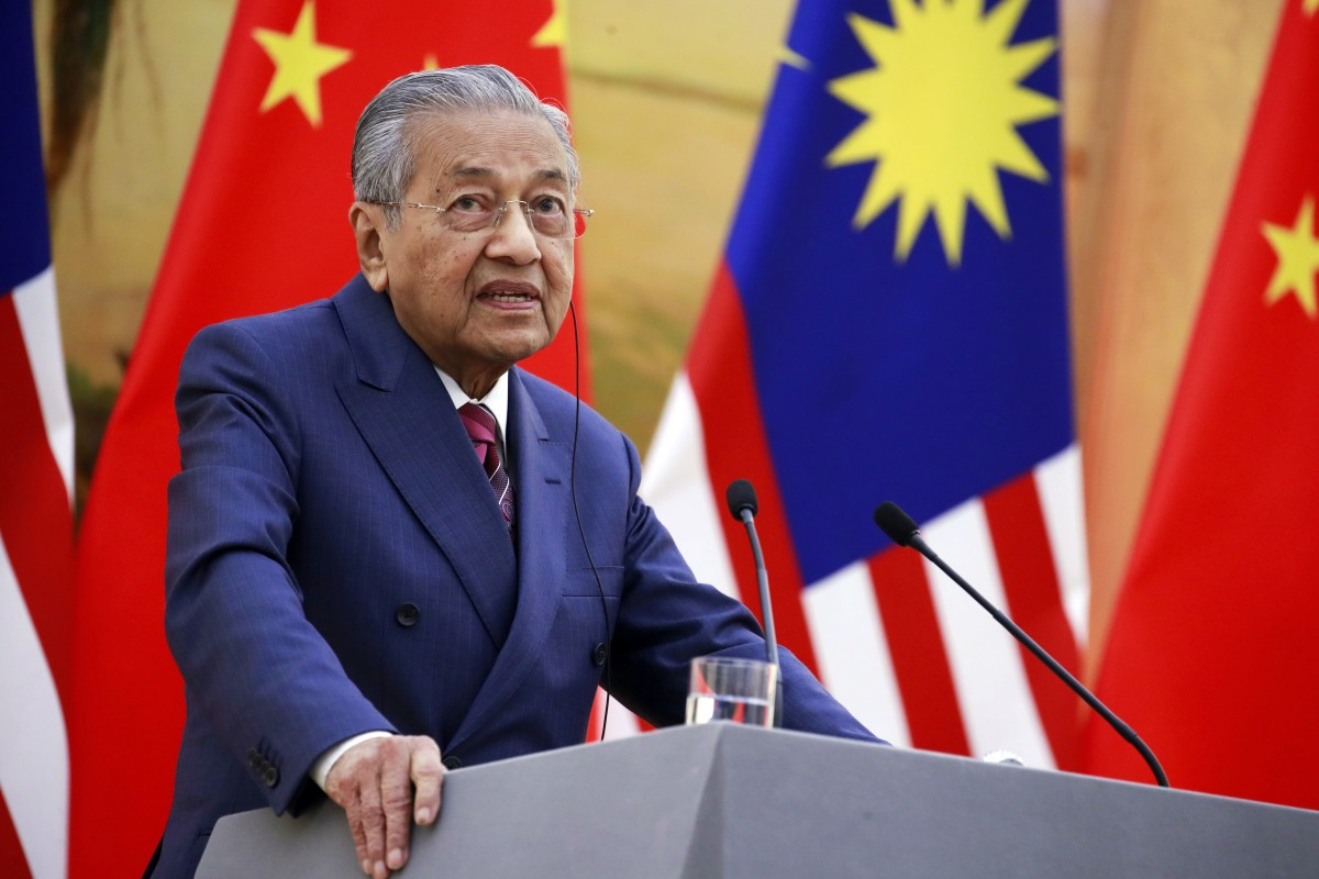 Malaysian Prime Minister Mahathir Mohamad speaks to reporters in Beijing last year. Photo: AP
