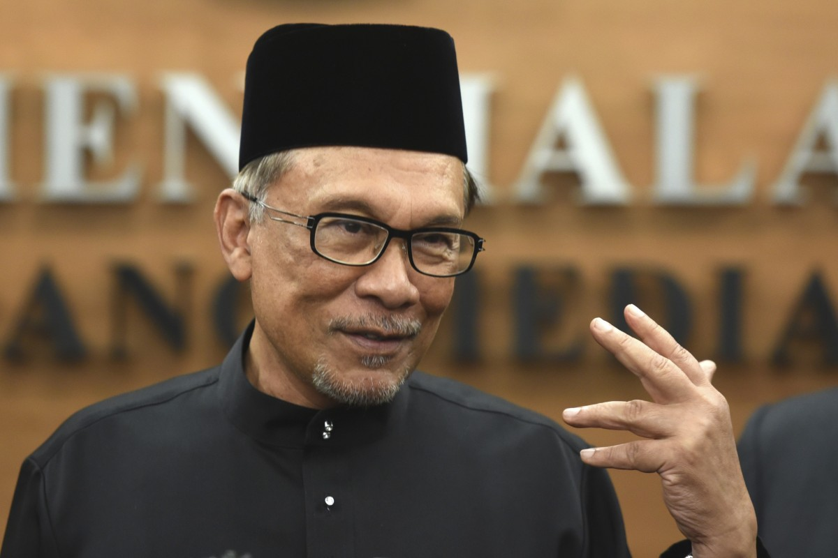 Anwar Ibrahim's top aide detained by Malaysian police in sex video scandal