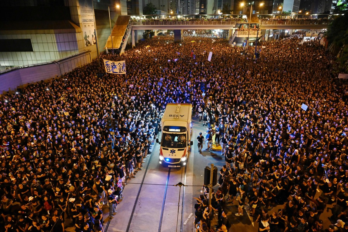 Image result for In Hong Kong, nearly two million protestors part like a wave to make way for ambulances video