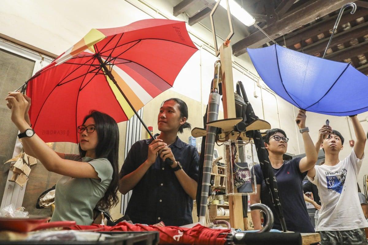 Hong Kong duo pushes for city to start sharing umbrellas ...