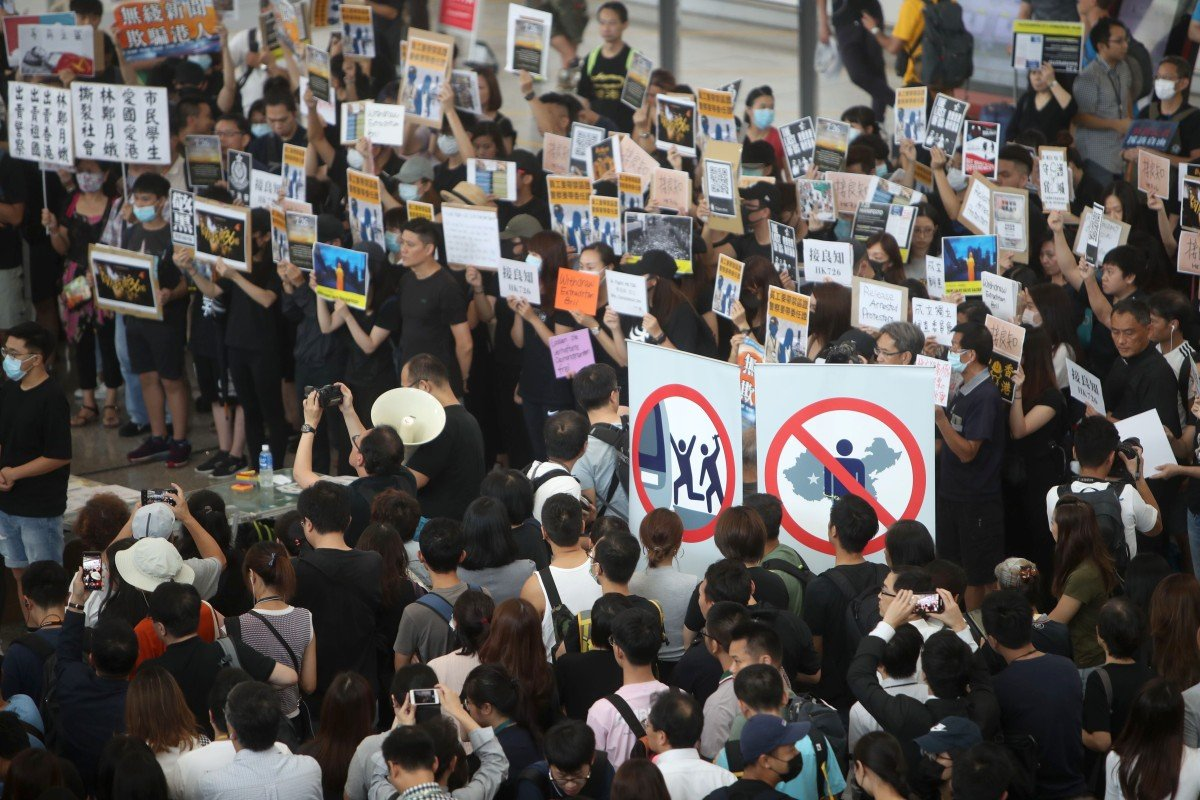 Protesters occupy part of Hong Kong International Airport to