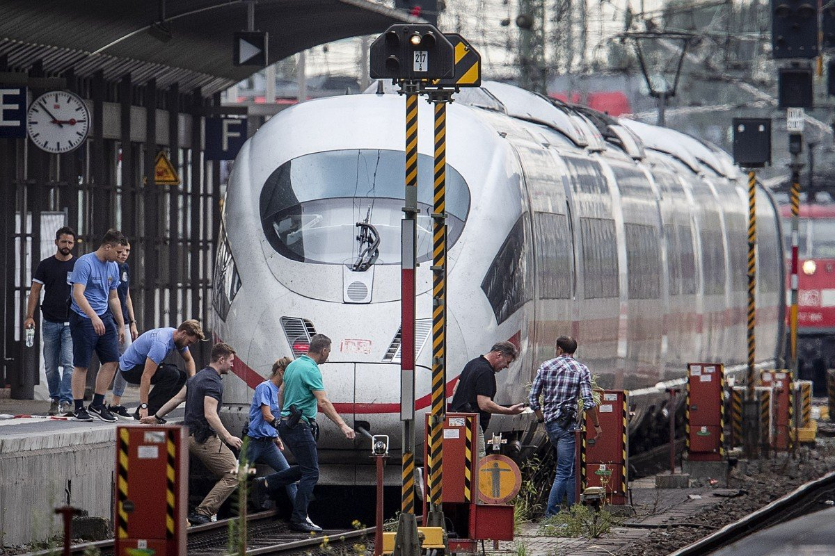 Boy, 8, killed by train in Germany after man pushes him onto