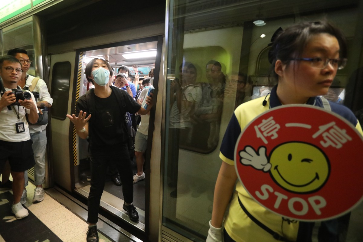 Protesters started blocking the doors of a train from Tiu Keng Leng MTR station shortly before 8am. Photo: Nora Tam