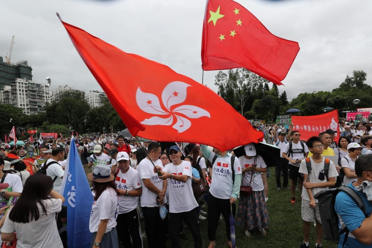 Thousands rally in support of Hong Kong's embattled police force ...