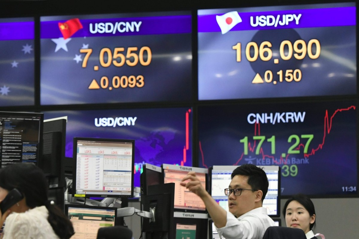 Australia weighs in on US-China currency row and trade war, calling