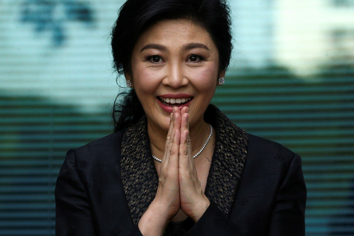 Former Thai prime minister Yingluck Shinawatra greets supporters as she arrives at the Supreme Court in Bangkok in August 2017. Photo: Reuters