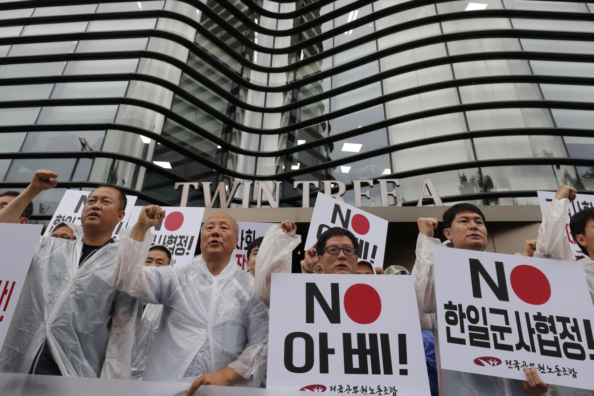 "South Korean protesters hold signs saying ""No Abe"" during a rally demanding the abolition of the General Security of Military Information Agreement. Photo: AP"