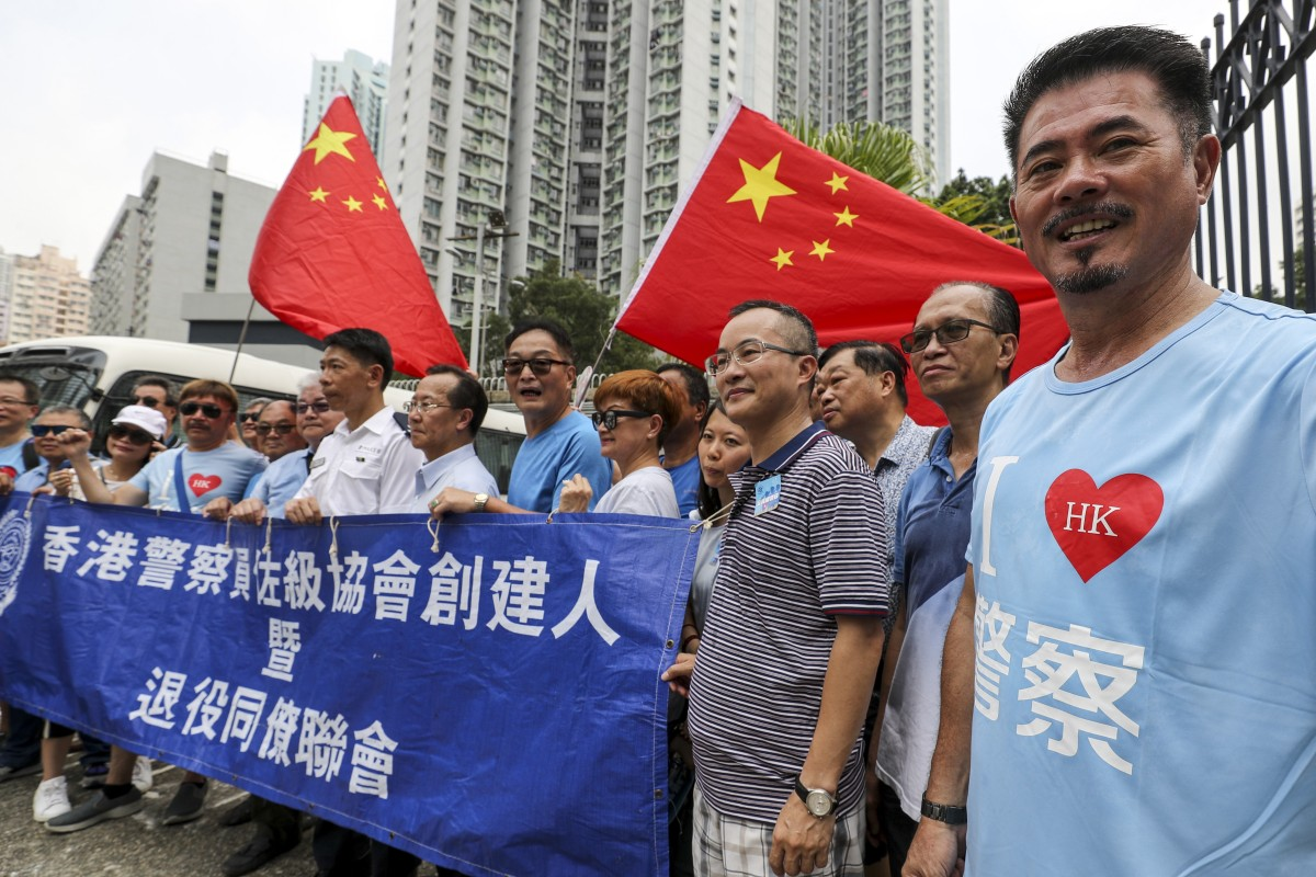 Hong Kong police supporters visit local stations to offer thanks to officers amid escalating...